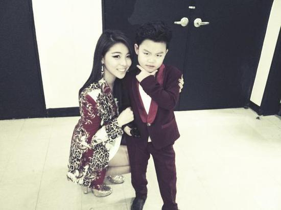 Singer Ailee Poses With Little PSY