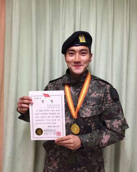 Super Juniors Choi Siwon Receives Award During Traditional Training