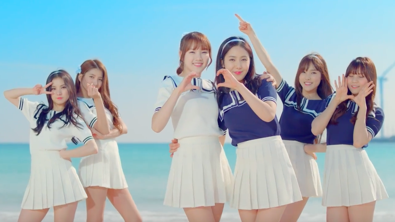 "Watch: GFRIEND Heads To The Beach In ""Wave"" MV For American Tourister"