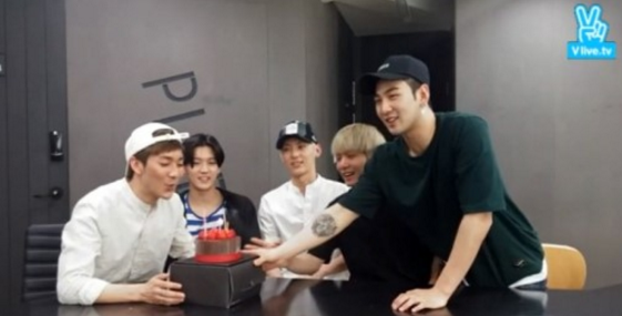 NUEST Surprises Aron With Birthday Cake During Live Broadcast