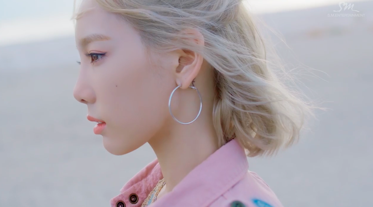 "Watch: Taeyeon Soaks Up The Sun In Solo Comeback ""Why"" MV"