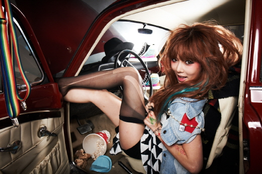 HyunA Rips Her Stockings Off in New Album Jacket Photos