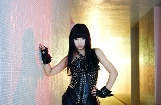 2NE1 member Minzy in Black and Pearls
