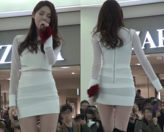 Kang Min Kyung Shows Off Her Body in a White Bandage Mini-dress