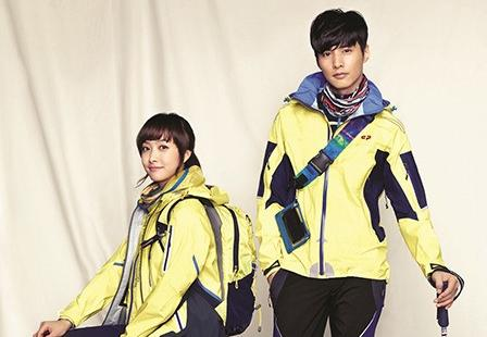 Won Bin poses with f(x)'s Victoria for Outdoor Gear Brand