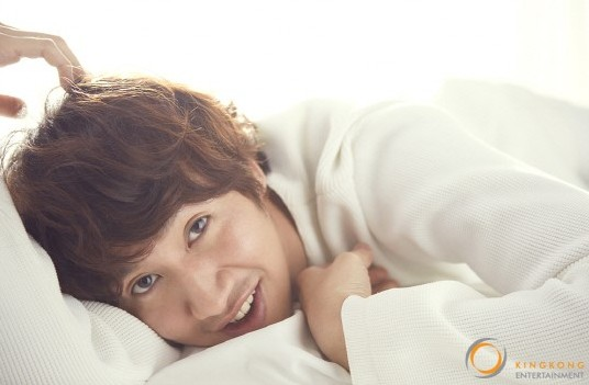 Lee Kwang Soo Becomes a Warm Spring Man for a Bedside Pictorial