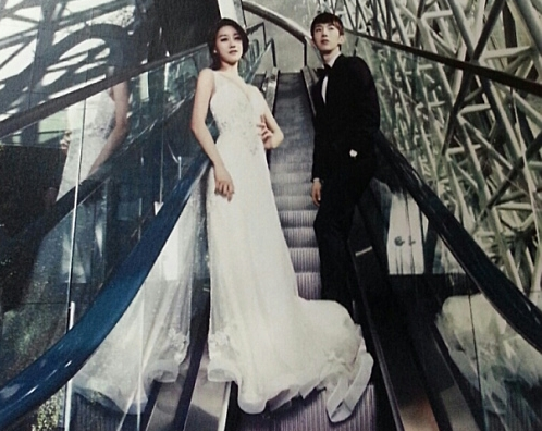 2AM's Jo Kwon and Rainbow's Oh Seung Ah Look Beautiful in Wedding Pictorial