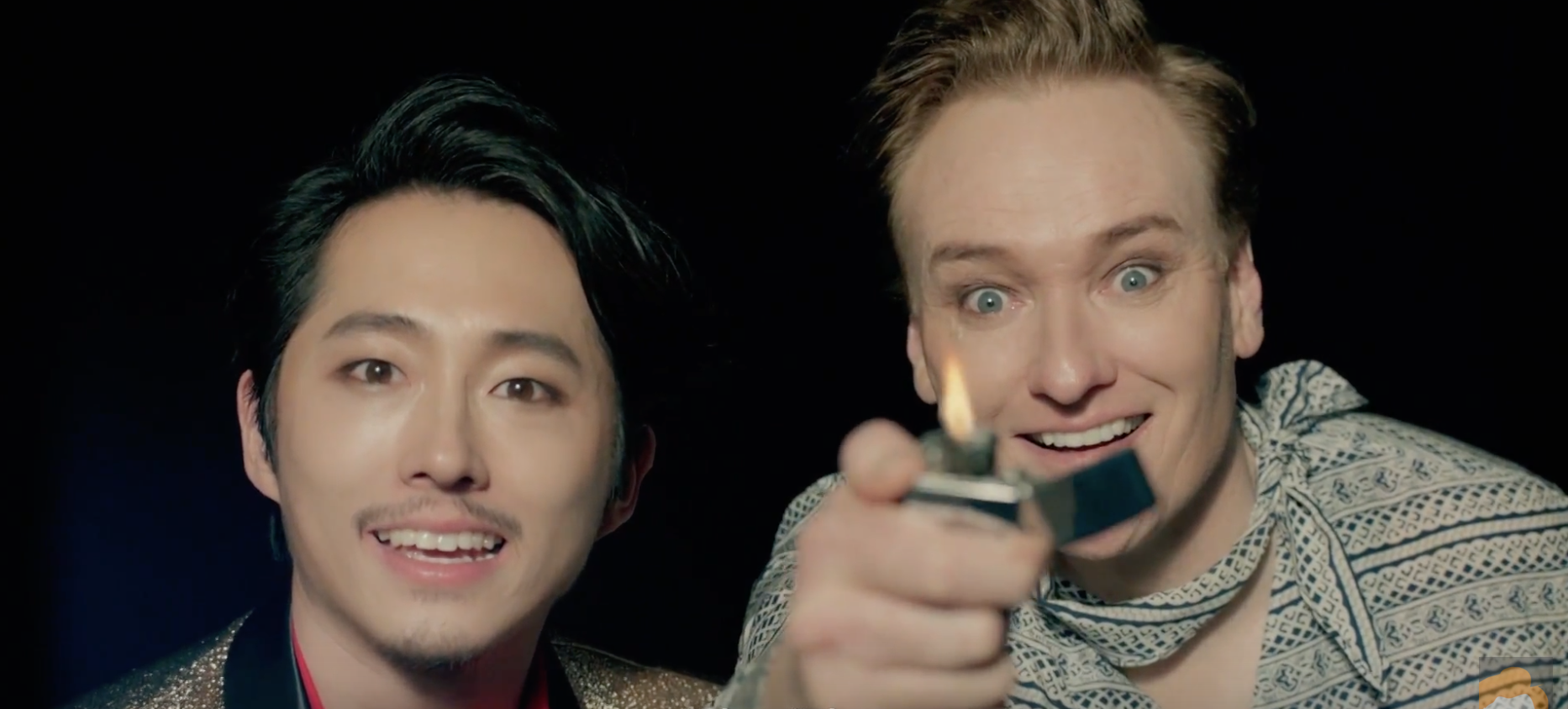 "Conan O'Brien and Steven Yeun Become K-Pop Stars in Park Jin Young's ""Fire"" MV"