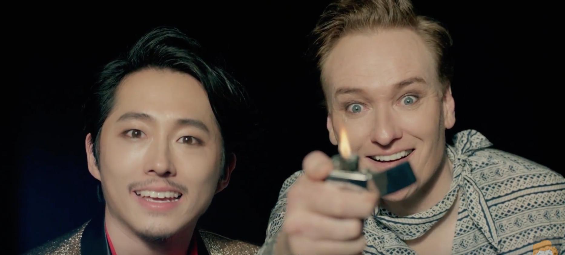 "Conan O'Brien and Steven Yeun Become K-Pop Stars in Park Jin Young's ""Fire"" MV"