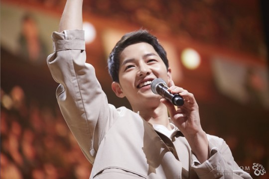 Song Joong Ki Gets Close and Personal at Seoul Fan Meeting; Donates All Proceeds