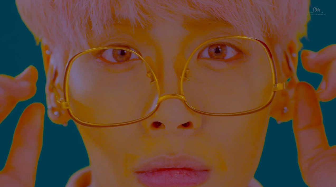 "Watch: SHINee's Jonghyun Returns With Funky ""She Is"" MV"