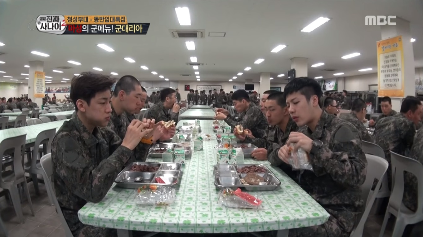 "Watch: GOT7's Jackson And BamBam Devour Famous Military Burgers On ""Real Men"""