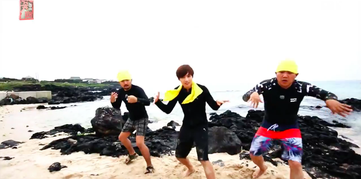 "Watch: BTS's Jungkook Films A Funny Beach Version Of ""Fire"" MV With Jo Se Ho And Yoo Byung Jae"