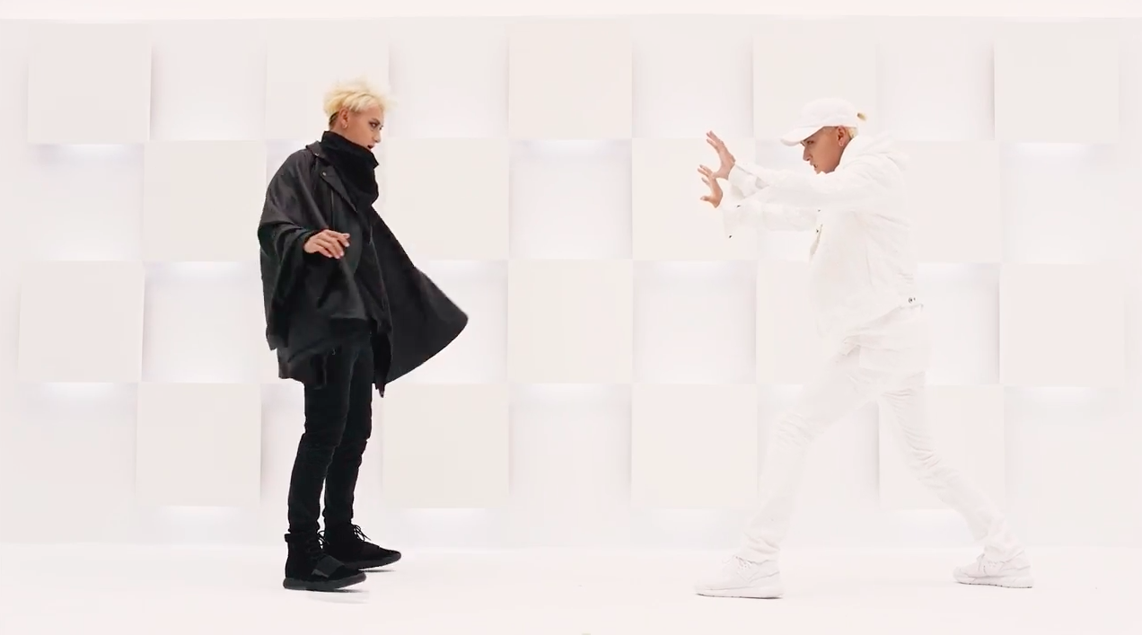 "Watch: Tao's Two Sides Face Off In ""Black White (AB)"" MV"