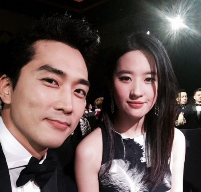 Song Seung Heon's Agency Responds To Rumors Of Breakup With Liu Yi Fei