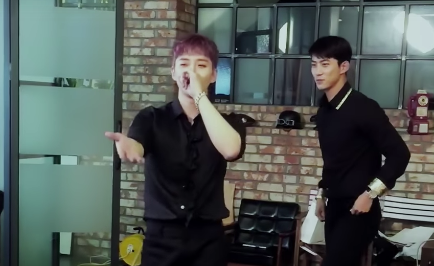Watch: 2PM's Junho Gets Taecyeon Adorably Riled Up