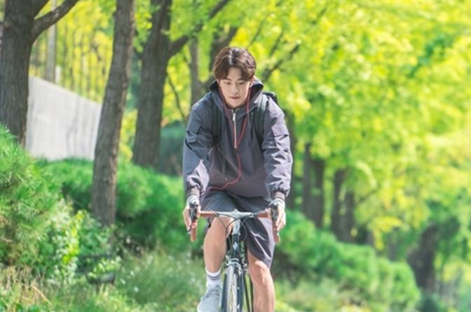 Nam Joo Hyuk Shows Off His Biking Skills In Stills For Upcoming Weightlifting Drama