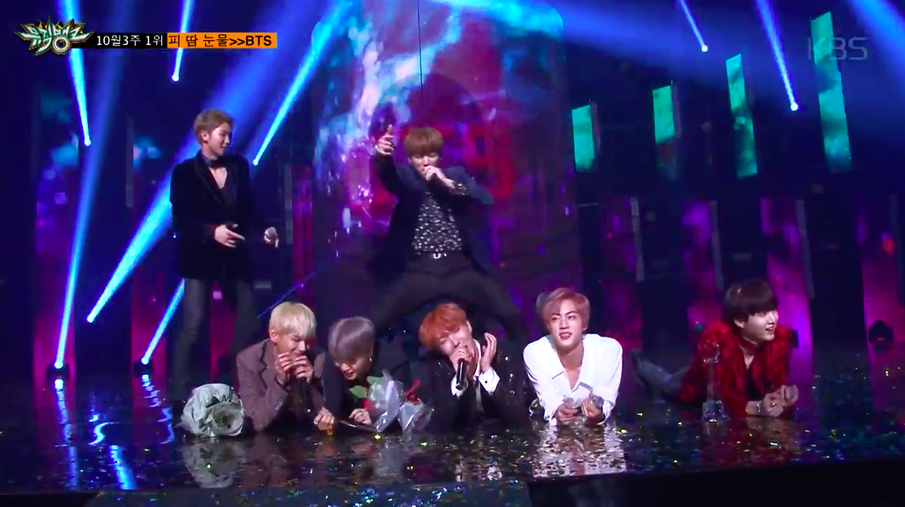 """Watch: BTS Shows Off Aegyo And Maknae Jungkook Literally Gets On Top In Full Version Of """"Music Bank"""" Encore"""