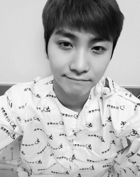 FTISLAND's Song Seung Hyun Undergoes 2nd Hand Surgery, Tells Fans Not To Worry