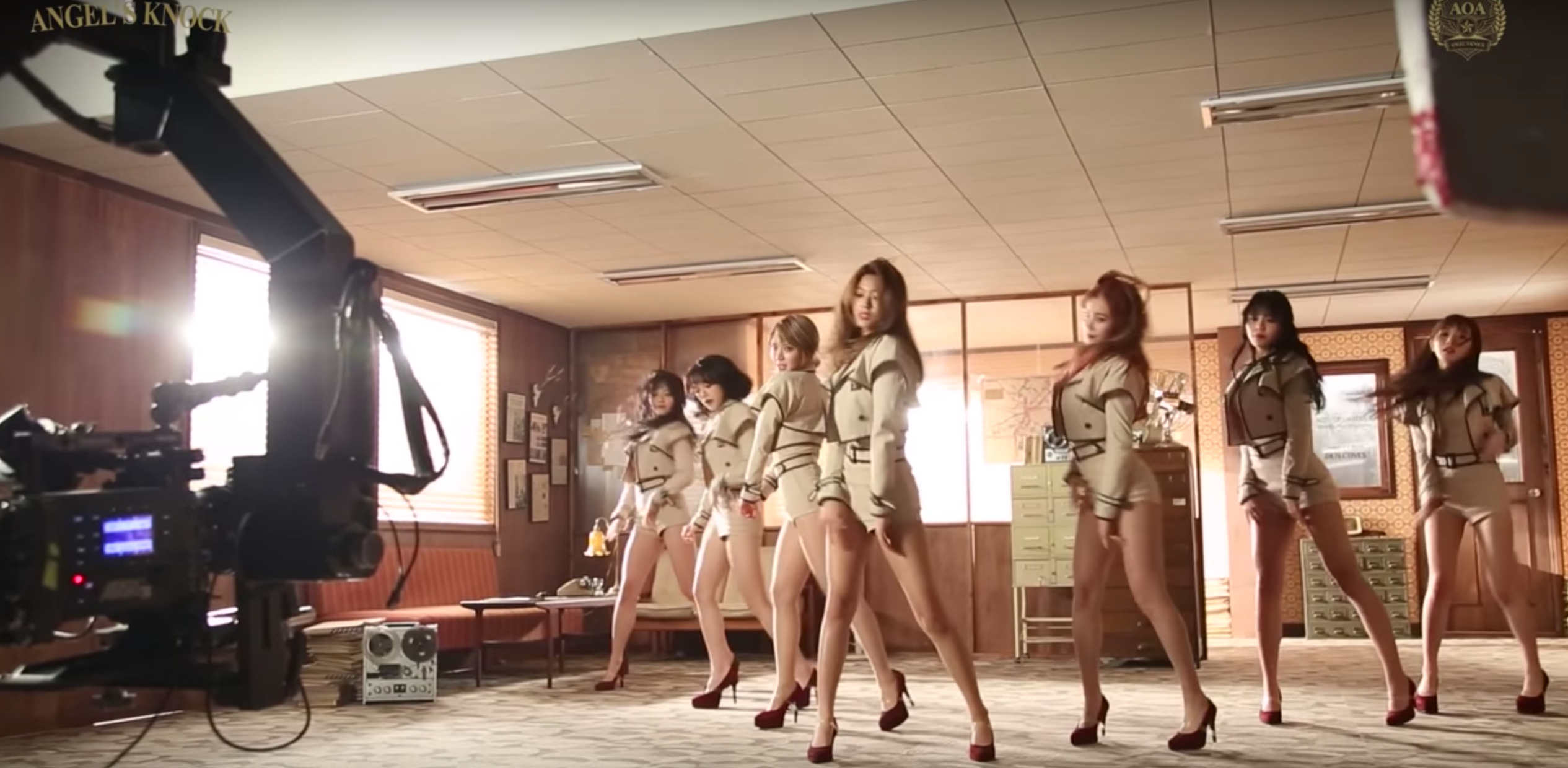 Watch: AOA Has A Fun Time Trying Out Magic Tricks And Detective Skills In MV Making Film