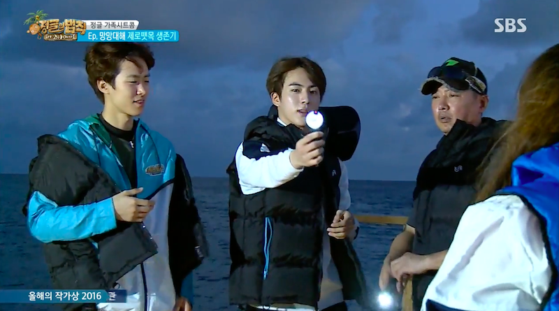 "Watch: Jin Shows ""Law Of The Jungle"" Cast Another Great Use For BTS's Light Sticks"