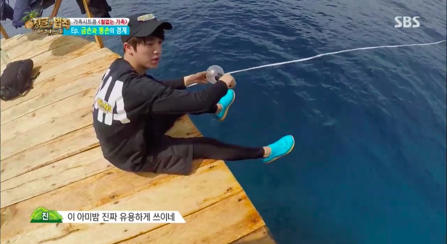 "Jin Tries Using BTS's Light Stick To Catch Fish On ""Law Of"