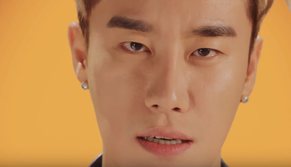 "Watch: San E Says ""I Am Me"" With Latest Music Video Featuring MAMAMOO's Hwasa"