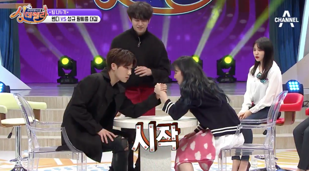 Watch: Red Velvet's Wendy Adorably Tries Arm Wrestling With INFINITE's Sunggyu