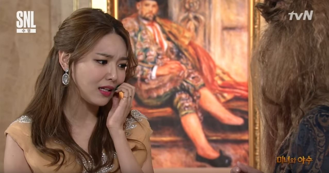 """Watch: Girls' Generation's Sooyoung Transforms Into Belle For """"Beauty And The Beast"""" Parody On """"SNL Korea"""""""