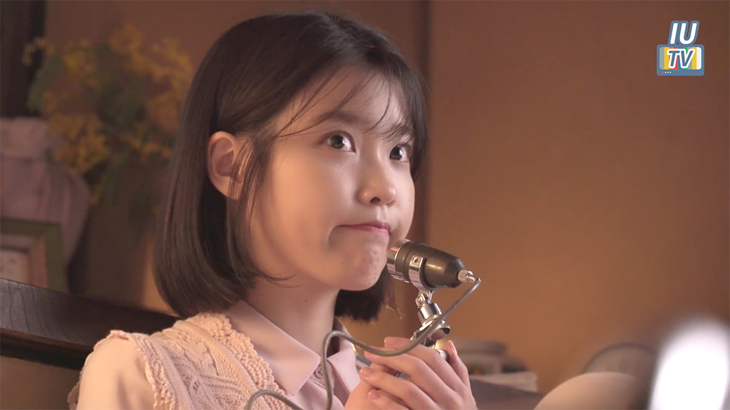 "Watch: IU Gets Playful In Both Versions Of The Behind-The-Scenes Video Of ""Through The Night"" MV"