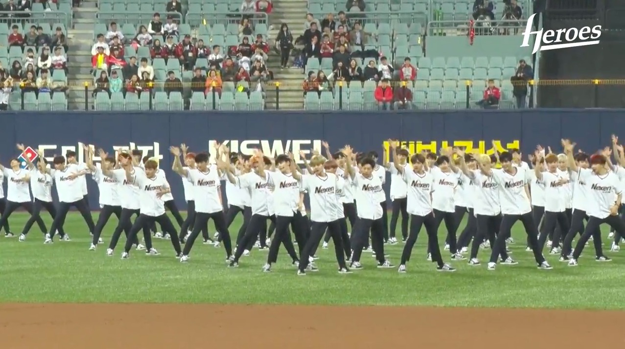 """Watch: """"Produce 101 Season 2"""" Contestants Perform Theme Song And Throw First Pitch At Baseball Game"""