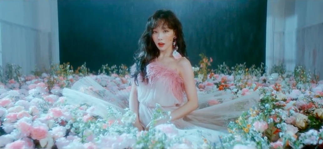 "Watch: Girls' Generation's Taeyeon Is A Spring Goddess In ""Make Me Love You"" MV Teaser"