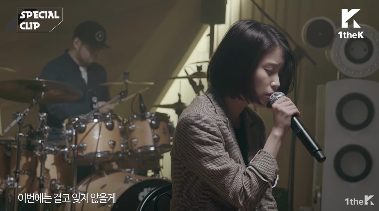 "Watch: IU Performs Moving Rendition Of ""Dear Name"" With Live Band"