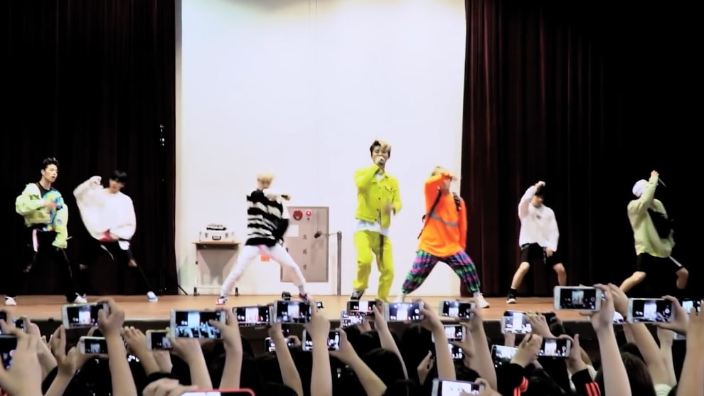 Watch: iKON Surprises Students At All-Girls High School And Performs BLING BLING