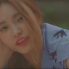 "Watch: Lee Jin Ah Looks Like The Star Of A Rom-Com In New MV For ""Random"""