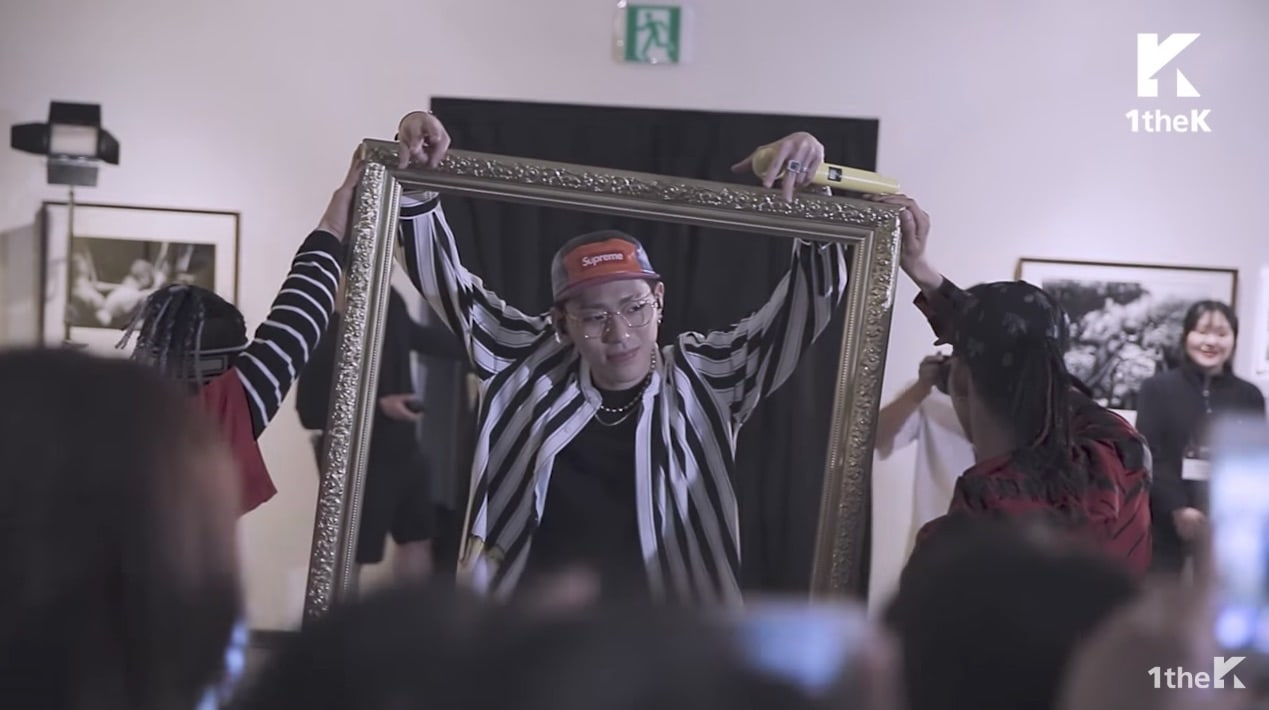 "Watch: Block B's Zico Surprises Art Exhibition Goers With Special Performance Of ""Artist"""