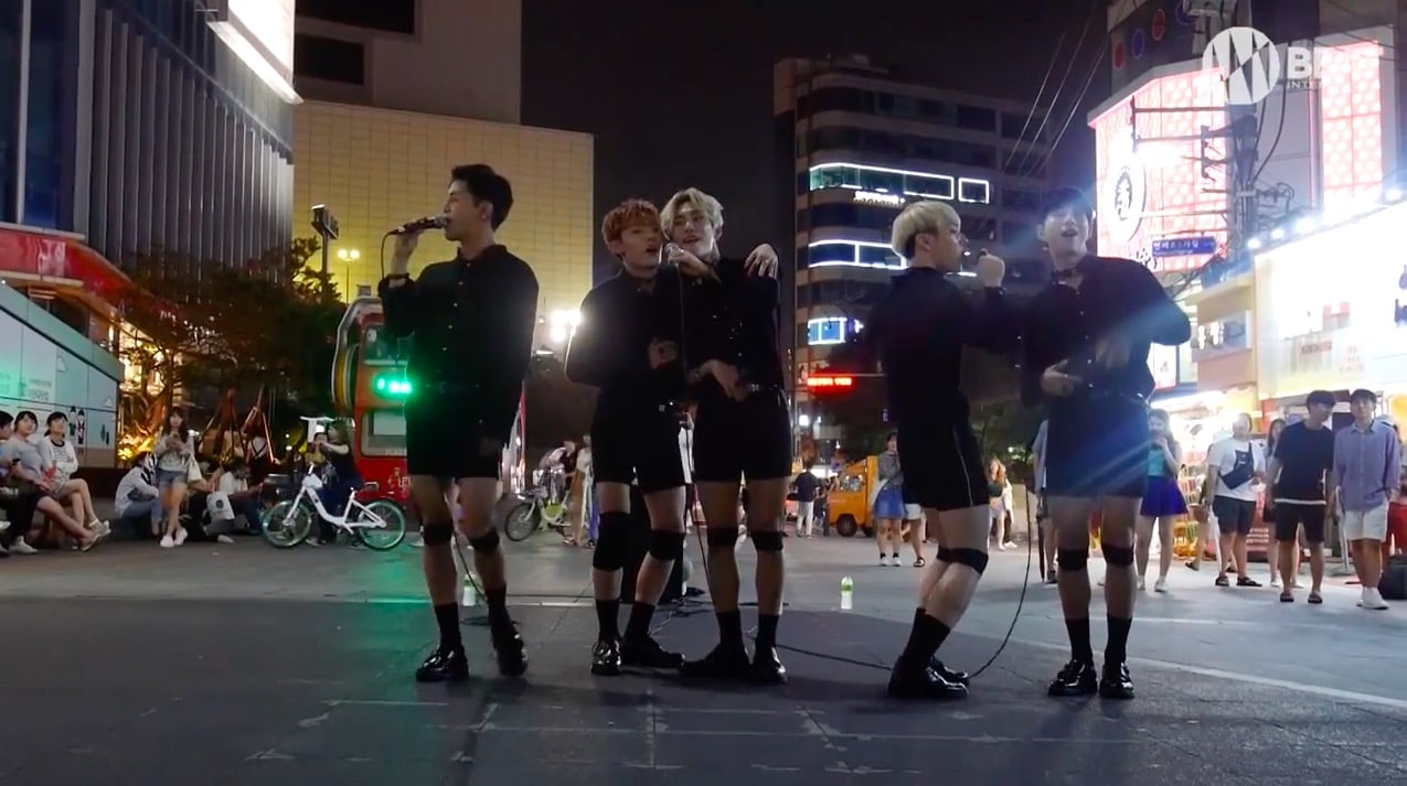"""Update: A.C.E Performs BLACKPINK's """"Playing With Fire"""" At Special Busking Event"""