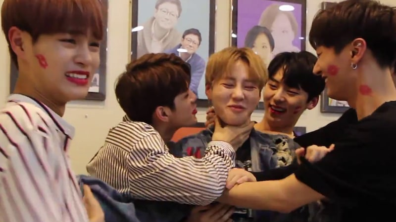 Watch: Wanna One Showers Each Other With Love Through Kiss Relay