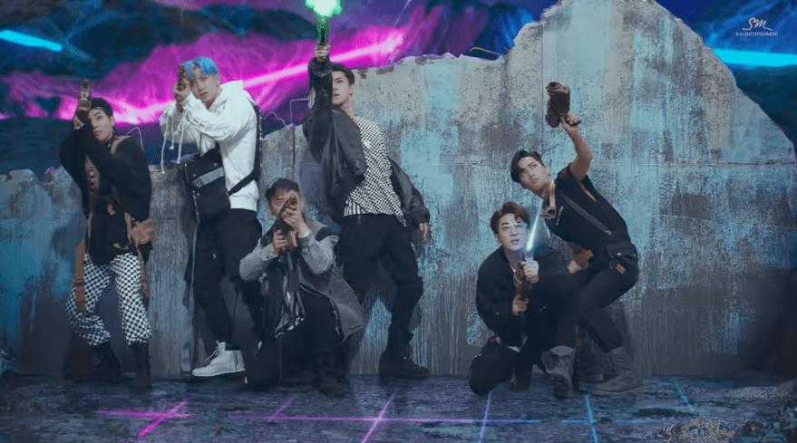 "Watch: EXO Members Fight To Regain Their ""Power[s]"" In Fun New MV"