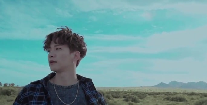 "Watch: 2PM's Junho Reveals Teaser For Solo ""Canvas"" MV"
