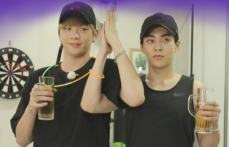 EXOs Xiumin And Wanna Ones Kang Daniel Bond In Stills For Its Dangerous Beyond The Blankets