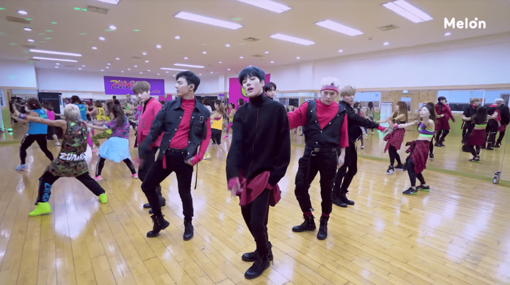 """Watch: MONSTA X Is Forced To Perform """"Dramarama"""" With No Music In Middle Of Jam-Packed Zumba Class"""