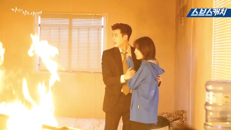 """Watch: Lee Jong Suk And Suzy Bravely Face The Fire In New Making Film For """"While You Were Sleeping"""""""