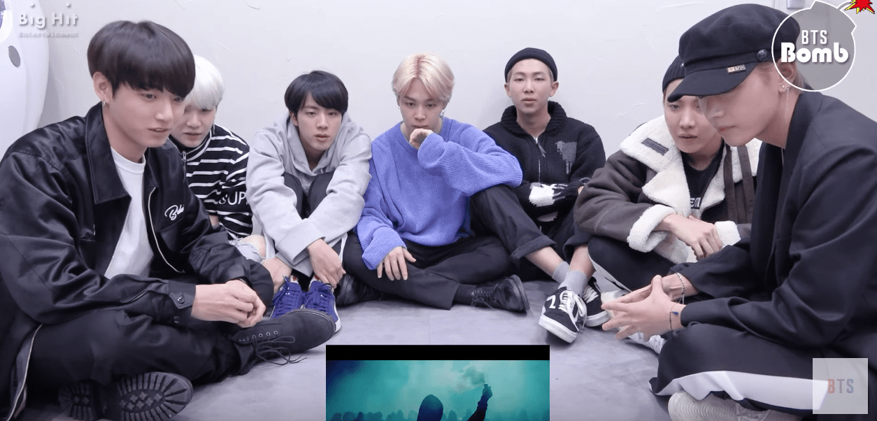 "Watch: BTS Can't Help But Be Mesmerized By ""MIC Drop"" MV"