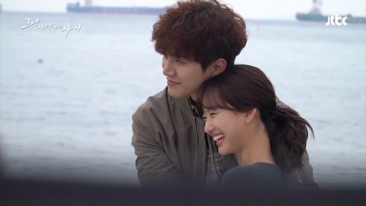 "Watch: 2PM's Junho And Won Jin Ah Are All Smiles During ""Just Between Lovers"" Poster Shoot"