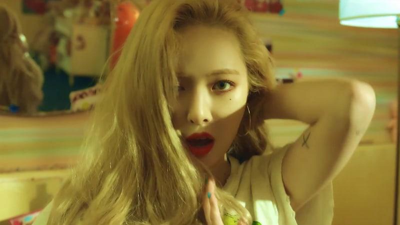 "Watch: HyunA Makes Fierce Comeback With MV For ""Lip & Hip"""