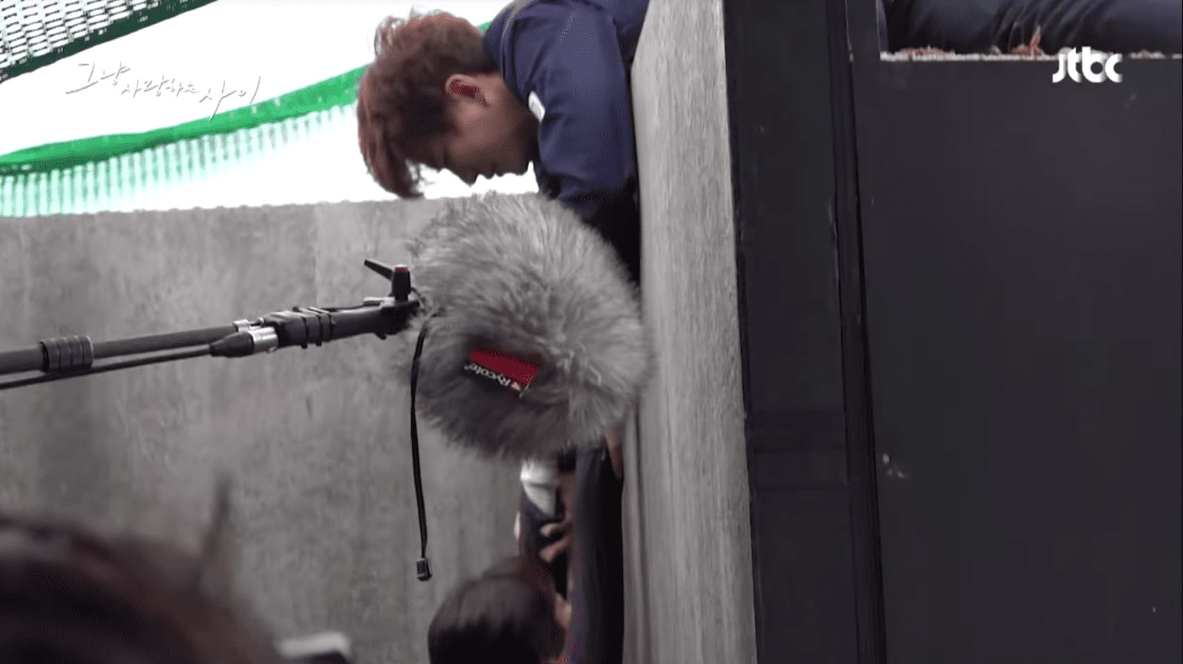 Watch: 2PM's Junho And Won Jin Ah Brave The Cold To Film Realistic Manhole Scene