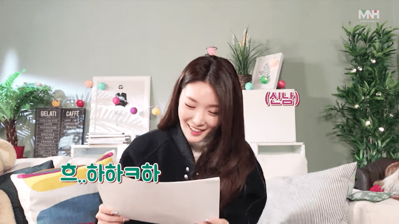 Watch: Chungha Reveals + Reacts To Official Logo And Fan Colors