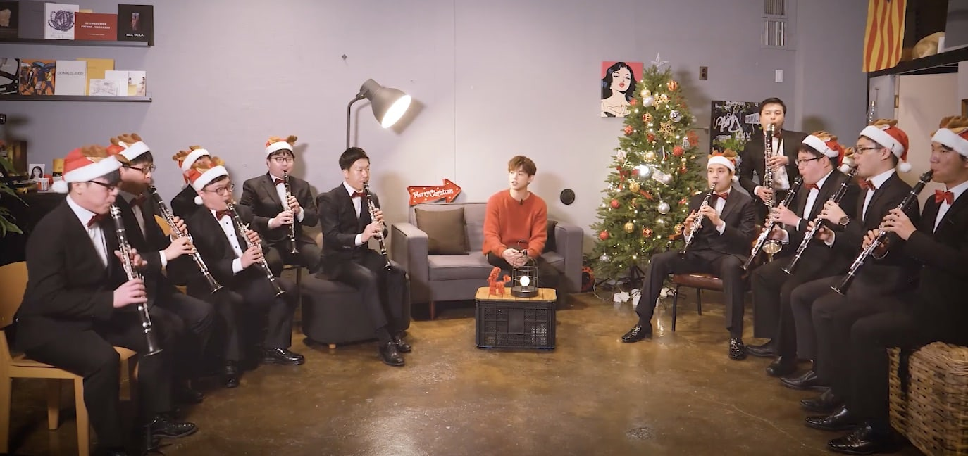 "Watch: Eric Nam Performs ""Jingle Bells"" With Ensemble Of Clarinet Players With Developmental Disabilities"