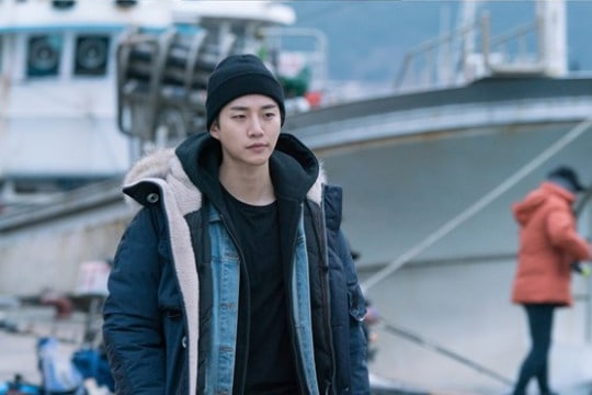 """2PM's Junho Is Alone At Sea In New Stills For """"Just Between Lovers"""""""